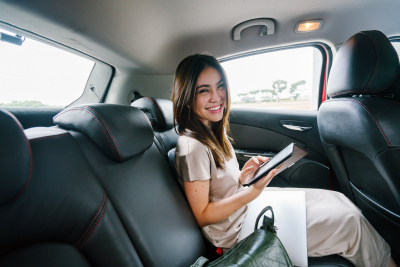 woman smiling inside limo