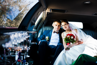 newlywed couple inside the limousine
